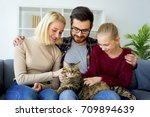 family with a cat | Shutterstock . vector #709894639