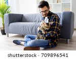 man with a cat | Shutterstock . vector #709896541