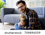 man with a cat   Shutterstock . vector #709896559