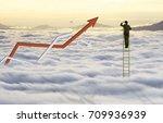 businessman climb ladder to... | Shutterstock . vector #709936939