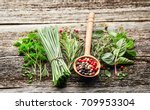 herbs on a wooden board | Shutterstock . vector #709953304