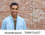 happy mixed race male smiling... | Shutterstock . vector #709971427