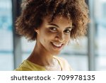close up of positive curly afro ... | Shutterstock . vector #709978135