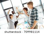 positive young colleagues... | Shutterstock . vector #709981114