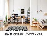young girl sitting at desk in a ... | Shutterstock . vector #709983055