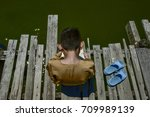 A Boy Reading A Book On A...