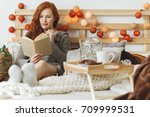 young woman eating chocolate... | Shutterstock . vector #709999531