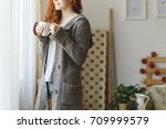 smiling woman in sweater... | Shutterstock . vector #709999579