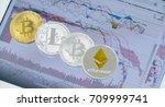 e coins set on tablet computer... | Shutterstock . vector #709999741