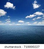 blue sea water surface on sky | Shutterstock . vector #710000227