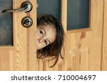 a child with a curiosity look... | Shutterstock . vector #710004697
