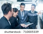 asian business team. image with ... | Shutterstock . vector #710005339