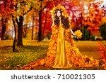 autumn woman fall leaves dress... | Shutterstock . vector #710021305