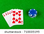 Poker hand Royal Flush Hearts With Betting Chips - stock photo