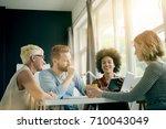 multi ethnic team having...   Shutterstock . vector #710043049
