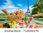 picnic in paris with wine ... | Shutterstock . vector #710043274