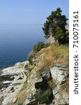 Small photo of Greece, Kavala, rocky shore with steps to Aegean sea