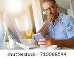 home office worker using... | Shutterstock . vector #710088544