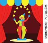 funny clown juggling performs.... | Shutterstock .eps vector #710103625
