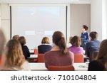 female speaker giving... | Shutterstock . vector #710104804