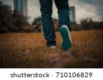 man jeans and sneakers shoes... | Shutterstock . vector #710106829