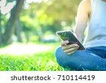 a asian woman using a smart... | Shutterstock . vector #710114419