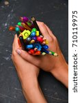 colorful pencils in hand... | Shutterstock . vector #710119975