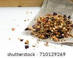 granola heap  isolated on white ... | Shutterstock . vector #710129269