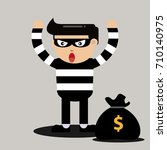 thieves raise their hands to... | Shutterstock .eps vector #710140975