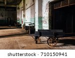 An Antique Wood Hand Cart With...