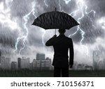 businessman hold black umbrella ... | Shutterstock . vector #710156371