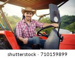 farmer driving tractor in the... | Shutterstock . vector #710159899