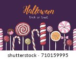 seamless halloween pattern with ... | Shutterstock .eps vector #710159995