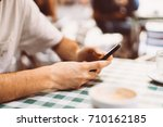 close up of a man using mobile ... | Shutterstock . vector #710162185