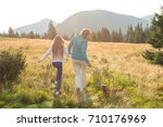 mom and daughter  holding hands ... | Shutterstock . vector #710176969