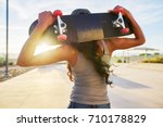 woman holding skate board... | Shutterstock . vector #710178829