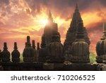 rising sun shining behind candi ... | Shutterstock . vector #710206525