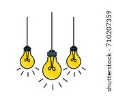 light bulbs hanging from the... | Shutterstock .eps vector #710207359