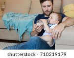 young father feeding his baby...   Shutterstock . vector #710219179