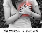 Small photo of Sporty woman having heart attack - Angina Pectoris, Myocardial Infarction