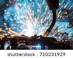welding robots movement in a... | Shutterstock . vector #710231929