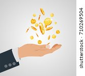 gold coin in hand businessman... | Shutterstock .eps vector #710269504