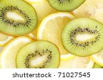 Kiwi And Lemon Slices On White...