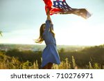 little girl holding USA flag
