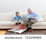 Boy And Grandfather With New...