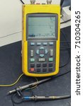 Small photo of Oscilloscope - Multimeter portable two-channel, switched on, close-up