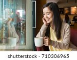asian woman sitting next to... | Shutterstock . vector #710306965