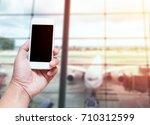 a man hand holding empty screen ... | Shutterstock . vector #710312599