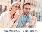 happy young couple.they are... | Shutterstock . vector #710313121