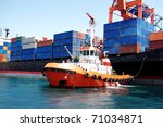 Tug Boat Pulling Out Container...